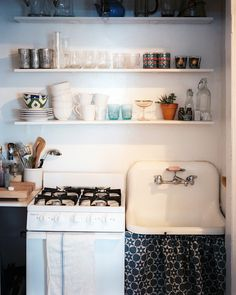 small kitchen - open shelves with glassware and dishes