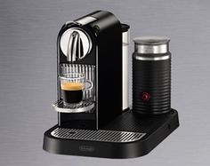 Nespresso- saw the George Clooney commercials when we were in Germany recently. Picked one up for Mike for Fathers' Day. Love it! Now I get a soy latte to go every morning on the MARC train!