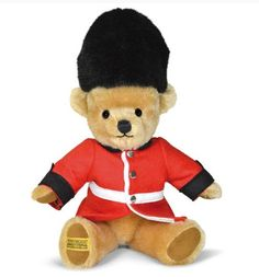 """London Gaurdsman Teddy bear [GM11GU] - """"London Gaurdsman"""" This delightful, fully jointed mohair bear is adorned in a beautifully made wool felt Guardsman outfit. The uniform is fully removable and finished with a co-ordinating 'Bearskin' hat - a true British icon and entirely handmade in England. Mohair 100% Wool Felt Luxury Plush Cotton thread Size:11"""" Presented in a free luxury Merrythought gift box.  Merrythought's"""