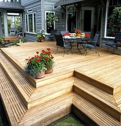 Love the slatted wood steps. Would love to create a multi level deck to replace the hideous round patio, and put sliding patio doors in my office. Wood Steps, Deck Steps, Sliding Patio Doors, New Deck, Building A Deck, Building Code, Building Plans, Decks And Porches, Patio Design