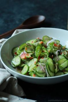 An easy to make Asian Cucumber Salad that's full of crunchy cucumber, rice wine vinegar, and a few secret ingredients! Can be served as a refreshing summer salad or the condiment to a sandwich! | joyfulhealthyeats.com Easy Healthy Recipes