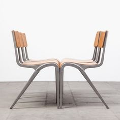James Leonard; Beech Plywood and Molded Aluminum Stacking Chairs for Esavian, 1948.