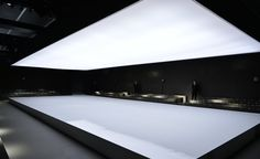Men's A/W 2014 season / Z Zegna: A peaceful setting greeted guests of Z Zegna's A/W show, with the catwalk taking centre stage as a white lacquered box, lit by an oversized hanging screen