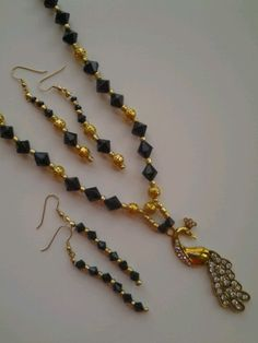 Black  and  Gold  Passion necklace and earrings set.