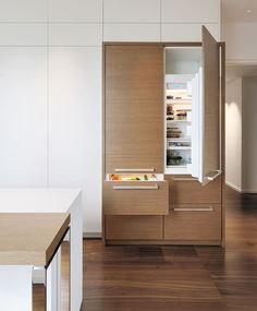 A walnut-paneled front on the Sub-Zero 700TCI Refridgerator/Freezer elevates the appliance to something both functional and stylish. Available at www.trevarrowinc.com #houstrends