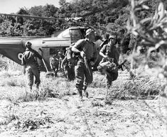 Soldiers disembark from a Westland Whirlwind helicopter, 1958.