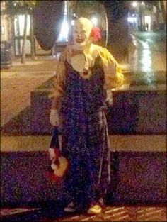 Bizarre: Appearances of the clown, who was seen waving and holding balloons and a teddy bear, had left residents of the Northamptonshire tow...