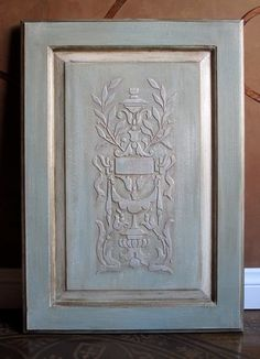 This cabinet door was done with a mix of Aubusson and Duck Egg Blue Chalk Paint® decorative paint by Annie Sloan and accented with Old White and clear and dark wax. It was done over the Royal Design Studio Parisian Swag Panel Stencil that was embossed with plaster.
