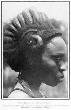 "Africa | Igbo woman. ""Hairdressing as a work of Art; charcoal dust and palm oil are freely used, but should necessity arise the structure must be cut away entirely as it cannot be undone"" 