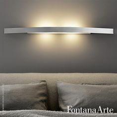 Comprising a structure in metal and diffusers in sandblasted tempered glass, FontanaArte Riga Wall Lamp provides downlighting and uplighting. #FontanaArte #walllamp #PaoloZani  Available at allmodernoutlet.com  http://www.allmodernoutlet.com/fontanaarte-riga-wall-lamp/