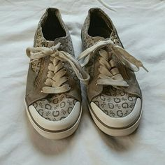 Guess shoes Used, but still in good condition. They are tan/grey, gold and white.  Make me an offer! No trades! Guess Shoes Sneakers