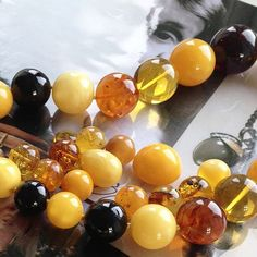 Amber occurs in a range of different colours, from pale yellow to brown tones. The stones are said to have healing properties.  #gemstones #amber #treeresin #mothernature #olelynggaard #olelynggaardcopenhagen #charlottelynggaard @charlottelynggaard_dk