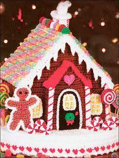 """Bring the color and fantasy of the famous Hansel and Gretel fairy tale to life with this enchanting gingerbread house reproduction in crochet! The detail of hand-stitched candy sticks, lollipops, gingerbread men, gumdrops and everything in between is breathtaking.Finished sizes: House (8"""" wide x 7""""deep x 10"""" high), Base (14"""" diameter).Skill Level: Intermediate"""