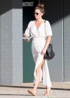 Jesinta Campbell in flowing white dress and strappy sandals.
