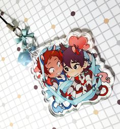 "2""+phone/zipper+charm,+featuring+Lance+and+Keith+of+Voltron:+Legendary+Defender. Printed+on+clear+acrylic,+comes+with+an+iridescent+(random)+jelly+star+charm+and+a+matching+bow+on+a+black+lariat.++"