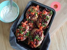 Stuffed sweet potato with beans, tomato, onion and bell pepper. So good!