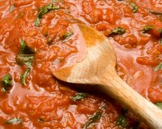 Tomato Sauce - olive oil - 6 garlic cloves - onions - red pepper flakes - 2 pints of grape tomatoes - basil