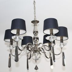 This elegant chandelier suits more contemporary, dramatic interiors. Having polished nickel arms and black crystal droplets, this 6 arm chandelier will command