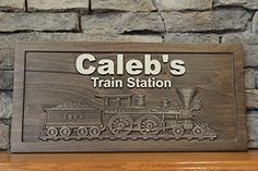 Train Sign Personalized Carved Sign Childrens Room Sign Custom Wood Sign Railroad Sign. This listing is for a beautifully carved wooden sign. The sign has a decorative carved train and Walnut rustic finish and can be personalized with a name or whatever you would like it to say. The sign is handcrafted and is multi stage finished which provides long lasting protection. Sign is finished on all sides and has 2 saw tooth hangers installed on the back. The sign is 23 inches wide and 11 inches...