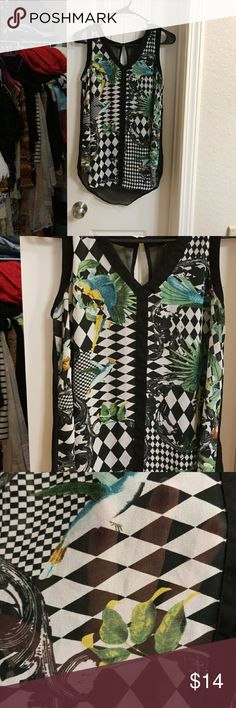 Adorable sheer high/low top Size small, semi sheer, flowing top with various tropical birds on front and button in back with keyhole opening in back. Tops