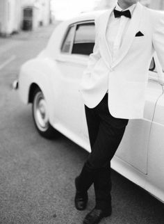 "White tuxedos can look cheesy if not tailored within an inch of its life. Confidence is key, and unless the dress code actually says ""White tie"" wear black."