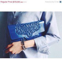 On Sale - Blue vegan clutch, vinyl clutch purse, modern design, minimal blue clutch, standout accessory,uniquely designed clutch by MeDusaBrand on Etsy https://www.etsy.com/listing/177897218/on-sale-blue-vegan-clutch-vinyl-clutch