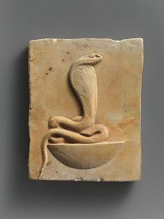 Relief plaque of cobra on a neb basket late Ptolemaic period. 400-30 BC Egypt,limestone