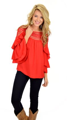 Detailed bell sleeves and a classic red color mean this shirt is ready for the holidays! $49 at shopbluedoor.com
