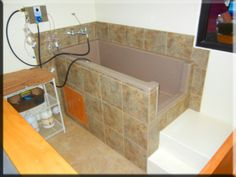 Love this tub. One thing I would add is put tile higher up on the wall.