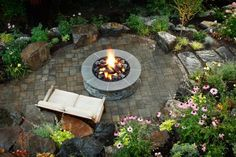 Surrounded by lush perennials, this outdoor lounge is relaxing whether the fire pit is in use or not.