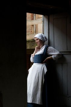 "https://flic.kr/p/gHU6m | Bakery Maid, Kentwell 1578 | A maid watches the dancing  outside her bakery at Kentwell Hall.  The  Great Annual Tudor Re-Creation"" features 300+ dedicated re-enactors in costume and in character around the Elizabethan house, farm and grounds. ..."