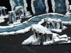 Snow and Ice Terrain. Waterfall River and stone barriers