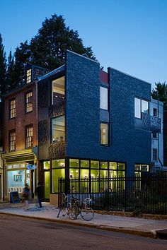 Rasmussen/Su designed this narrow addition to bridge between a historical 19th-century rowhome and a community garden located in the heart of Philadelphia's Washington Square West neighborhood. The lines of the openings in the original brick carry through to the weathering steel panels of the façade, into which were cut a pattern of interconnected ginkgo leaves adapted from a traditional Japanese paper carving.