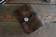Hand bound, hand stitched leather book. 192 hand torn pages (front and back), cream colored acid free paper. Real antler button. A great