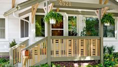 Front Porch Railing Give your home an exterior facelift by replacing worn or dated porch railings with custom wood railings topped by an overhead structure.