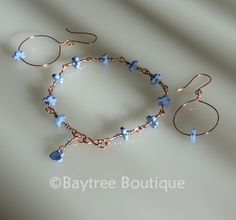 Copper wire and polymer clay forget-me-not charm bracelet and earrings.  Finished with polymer clay heart charm.