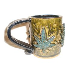 Cannabis Cup  Handbuilt ceramic coffee mug decorated with small, detailed marijuana leaves by Aaron Nosheny / Aberrant Ceramics $34.00