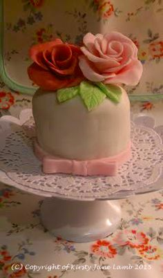 Mini wedding cake - vanilla sponge sandwiched together and iced with strawberry butter cream icing, covered with white fondant icing and decorated with my hand made fondant roses - a pretty delicious treat...x