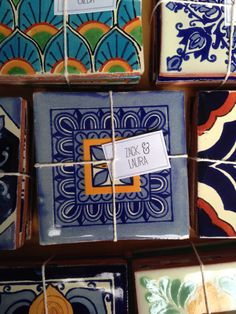 Various 4x4 Mexican/ Spanish Decorative Ceramic Talavera Tiles wrapped up with initials and a heart stamped on the back. These are colorful,