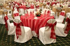 Organza striped linens and sashes make this wedding reception romantic in red.