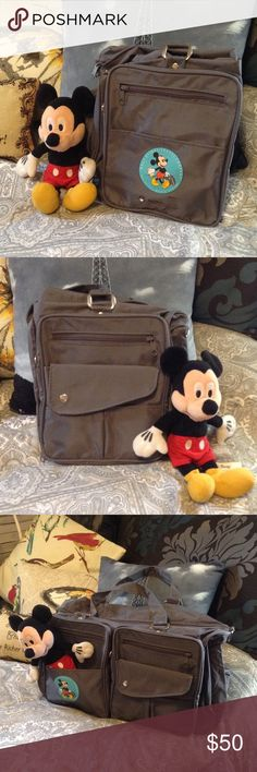 Disney Exclusive Travel Duffle Bag ☀️❤️ BRAND NEW, NEVER USED, Fantastic Travel Bag. Charcoal Gray with Cute Blue Logo of Mickey Mouse and his Suitcase. Has Multiple Pockets and Zippers. Has Shoulder Strap and Two Handle Straps. Folds and Zips for Storage. Keep this in your luggage for all those extra goodies you purchased on your Cruise, Disney Trip, Vacation, etc. Wipes Clean! Walt Disney Travel Club Exclusive...you can't find this anywhere! Disney Bags