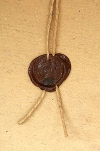 Make a wax seal using a crayon in a glue gun...Yes, you will need a new glue gun when you're done.