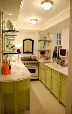 Don't like the shade of green, but I do like the organization of a galley kitchen. The mirror makes it look longer