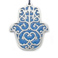 Hamsot (plural for hamsa, a Middle Eastern / North African talisman that wards off the evil eye) hang all over my apartment.