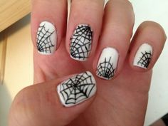 Glow-in-the-dark spider web nails (in light)