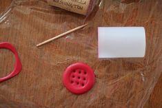 9-hole button tutorial from DesignSponge. Make any letter! Whoo!