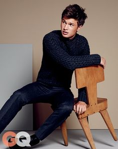 Ansel Elgort - Sweater: $1395, polo shirt: $325, pants: $575, boots: $954 by Calvin Klein Collection