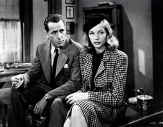 """""""The Big Sleep"""" (1946) film noir directed by Howard Hawks, the first film version of Raymond Chandler's 1939 novel of the same name. The movie stars Humphrey Bogart as detective Philip Marlowe and Lauren Bacall as the female lead in a story about the """"process of a criminal investigation, not its results."""" William Faulkner, Leigh Brackett, and Jules Furthman co-wrote the screenplay."""