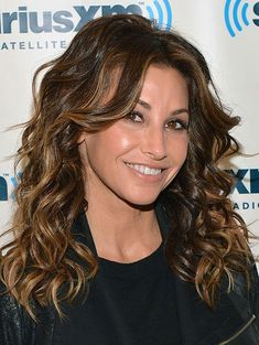 """Shoulder-Length and Curly To get the spring back in your spirals, ask your stylist for a shoulder-length cut with layers throughout, like Gina Gershon's 'do. """"If your cut doesn't have any layer or dimension to it -- it will look too boxy,"""" he says. Summer Hairstyles, Easy Hairstyles, Bob Haircut For Fine Hair, Shoulder Length Hair, Gina Gershon, Hair Lengths, Hair Trends, Hair Inspiration, Spirals"""