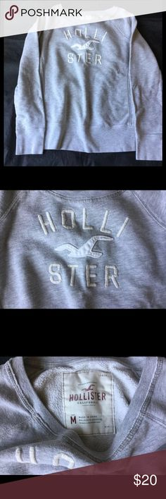 Hollister Pullover Sweatshirt Crew Neck Excellent condition normal pulling from washing. Hollister Tops Sweatshirts & Hoodies